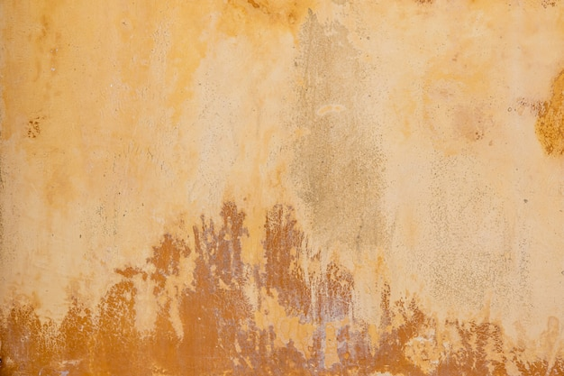 Vecchio fondo della parete di colore marrone chiaro del cemento.