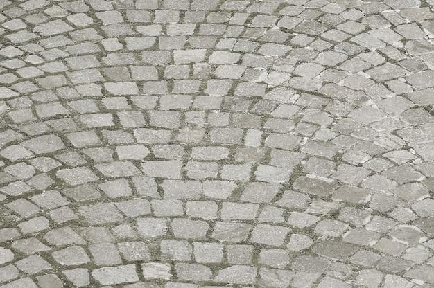 Vecchio fondo della pavimentazione della pietra di gre