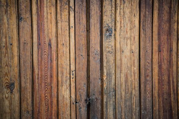 Vecchio fondo di legno con i bordi verticali