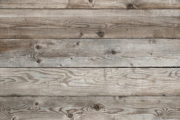 Vecchio fondo di legno della parete del granaio