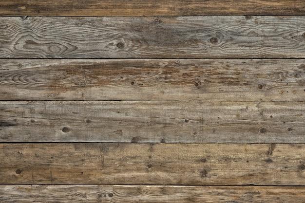 Vecchio fondo di legno scuro naturale sbiadito del pino smussato