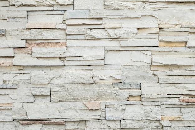 Vecchio fondo di pietra di struttura del muro di mattoni del primo piano