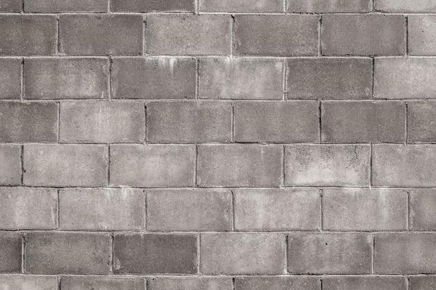 Vecchio fondo di struttura della parete dei blocchi in calcestruzzo.