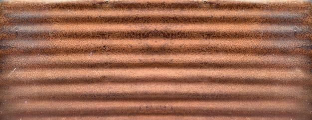 Vecchio fondo di struttura dello zinco, arrugginito sulla superficie di metallo galvanizzata.