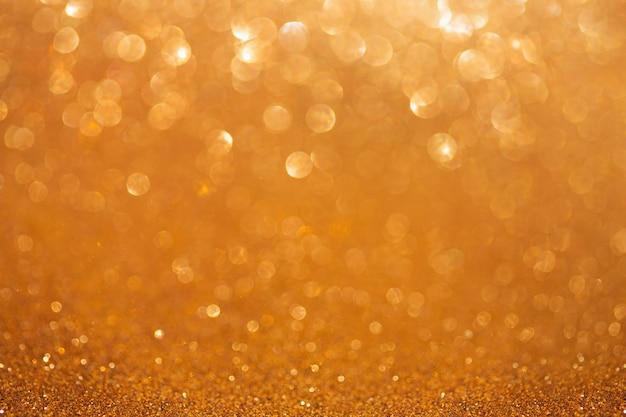 Vecchio fondo dorato del bokeh, estratto con le luci defocused.