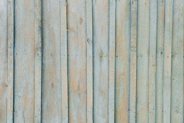 Vecchio fondo in legno di tavole con vernice screpolata e peeling