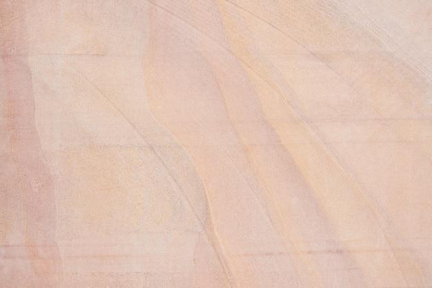 Vecchio fondo rosso di struttura della parete di pietra della sabbia.