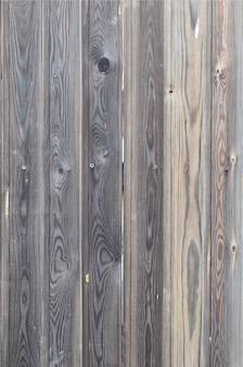 Vecchio modello di legno del pannello di marrone scuro di lerciume con il bello texturele astratto della superficie del grano
