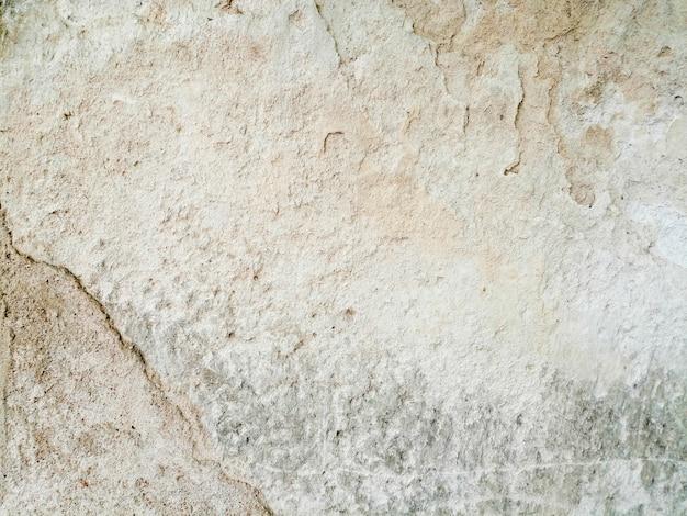 Vecchio muro bianco sullo sfondo