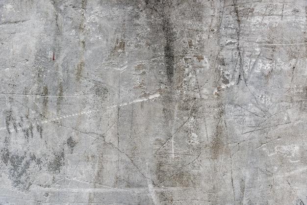 Vecchio muro di cemento con graffi