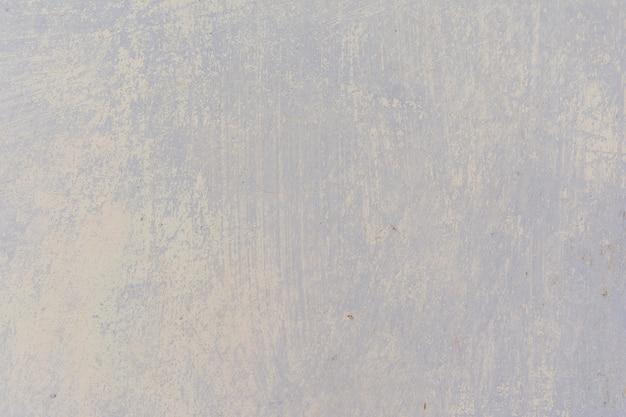 Vecchio muro di cemento verniciato con tutti i colori antichi strati sullo sfondo artistico