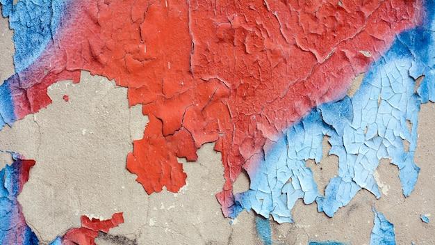 Vecchio muro di graffiti urbani