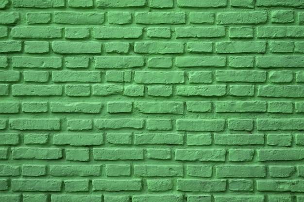 Vecchio muro di mattoni colorato verde per fondo