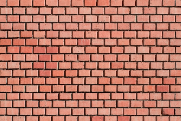 Vecchio muro di mattoni muratura da un vecchio mattone in stile rustico. la struttura e il modello del muro di pietra distrutto. copia spazio.