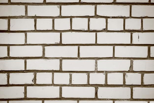Vecchio muro di mattoni realistico fatto di mattoni bianchi