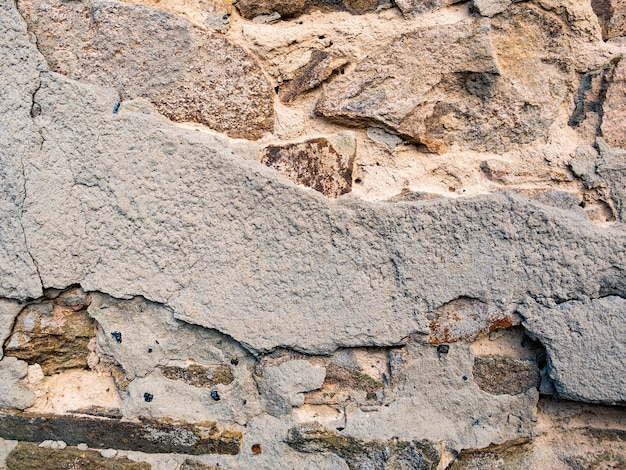 Vecchio muro di pietra grunge texture di sfondo