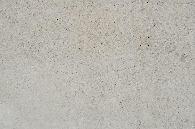 Vecchio pavimento della parete del cemento vago con fondo vago