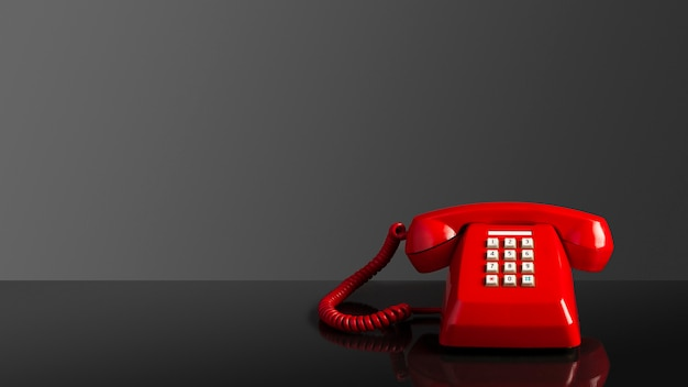 Vecchio telefono vintage rosso su sfondo nero