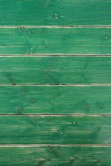 Vecchio verticale di legno di struttura del fondo dipinto verde d'annata