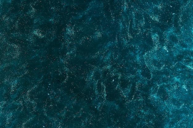 Vernice azzurra che si diffonde con l'acqua