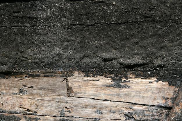 Vernice nera in legno scafo in legno invecchiato