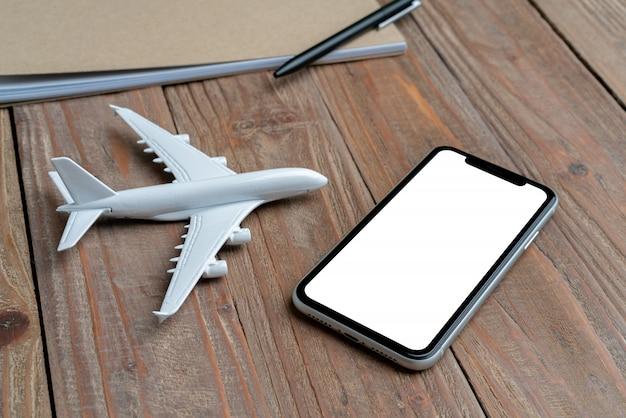 Viaggio e aereo e display bianco