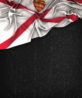 Vintage bandiera jersey su una lavagna nera grunge con spazio per il testo