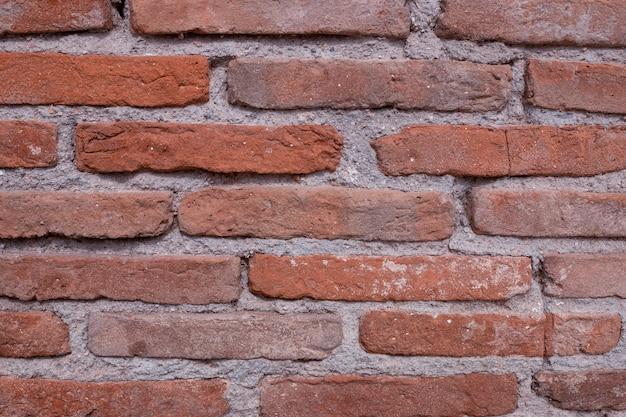 Vintage muro di mattoni rossi. sfondo grunge