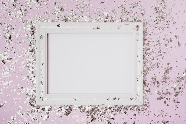 Vista dall'alto copia spazio cornice mock-up con glitter