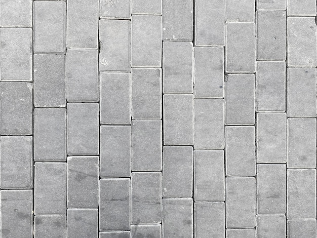 Vista dall'alto del cemento grigio blocca il percorso modo sfondo del pavimento.