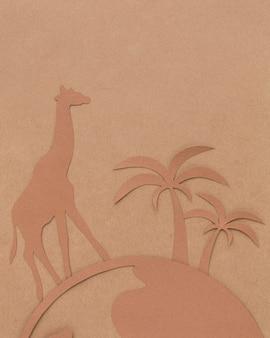 Vista dall'alto del pianeta di carta con animali per la giornata degli animali