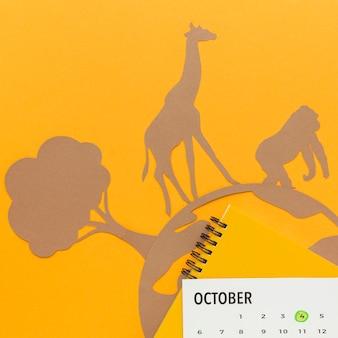 Vista dall'alto del pianeta di carta e degli animali per la giornata degli animali