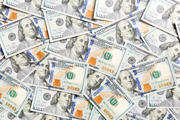Vista dall'alto di denaro americano. mucchio di dollari in contanti. banconote di carta