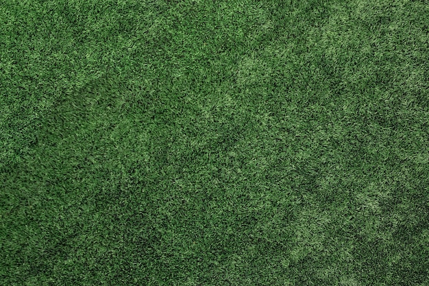 Vista dall'alto di erba artificiale, trama di prato verde artificiale.