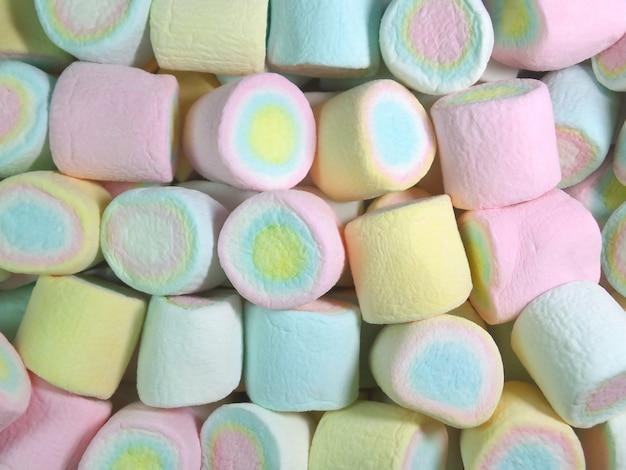 Vista dall'alto di pastello blu, rosa, giallo marshmallows colorate per sfondo, texture
