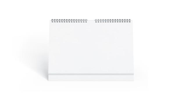 Vista frontale del calendario bianco in bianco, isolata