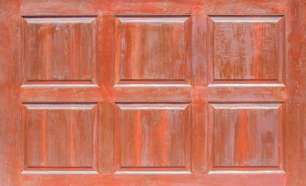 Vista frontale del pannello di legno del modello, della finestra o della porta dei pannelli di legno di lerciume della parete di legno usati come fondo