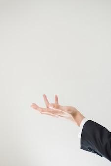 Vista laterale della mano con spazio di copia