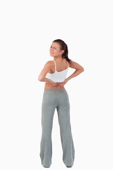 Vista posteriore della donna con mal di schiena