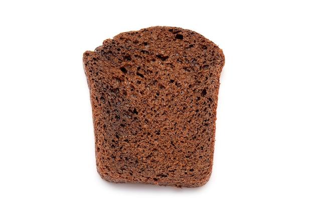 Vista superiore del pane nero del multi grano della fetta isolato su bianco