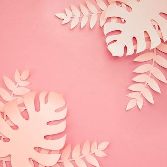 Vista superiore delle foglie casalinghe artificiali rosa di monstera