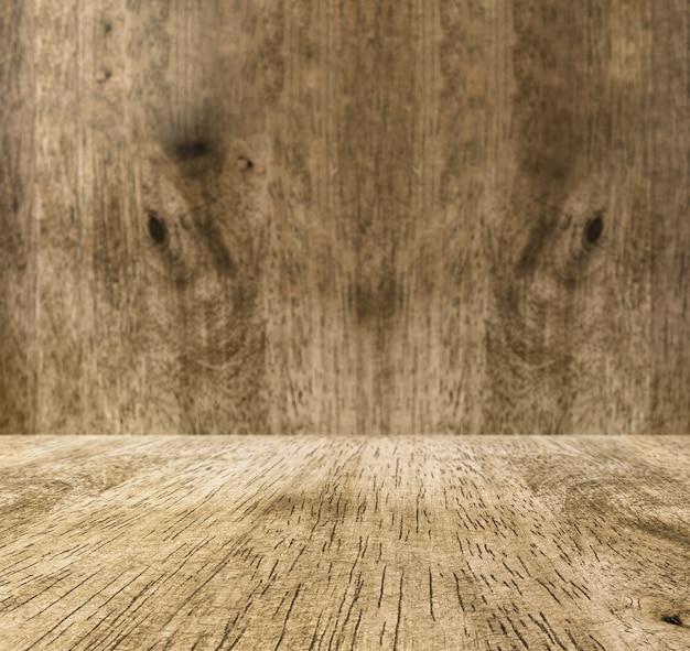 Vuotare il pavimento in legno e sfocatura parete in legno, mock up room per la visualizzazione del prodotto o utilizzare come sfondo.