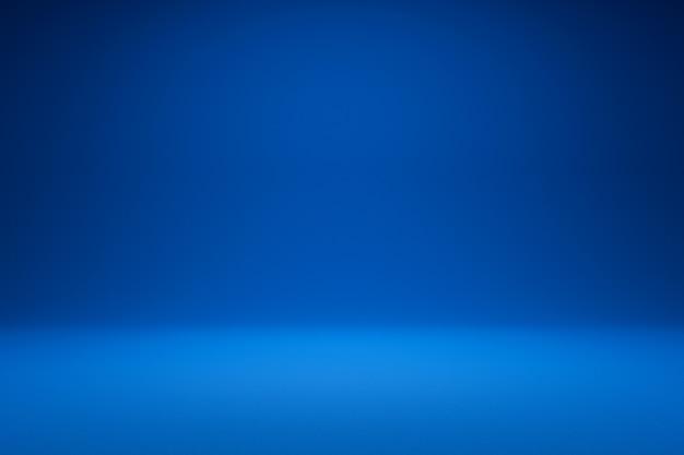 Vuoto sfondo blu e riflettori. rendering 3d realistico.