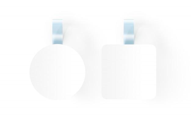 Wobblers bianchi in bianco che appendono sulla parete