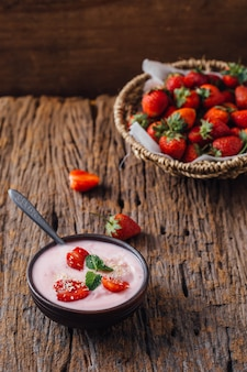 Yogurt strawberry on wooden table background