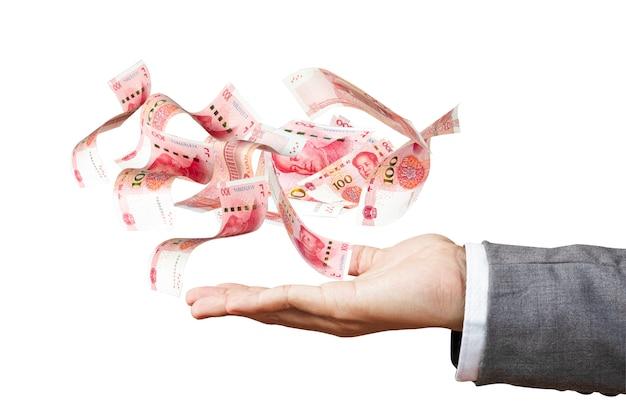 Yuan antigravità di volo delle banconote sulla mano dell'uomo d'affari