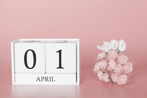 01 de abril. dia 1 do mês. cubo de calendário na rosa moderna
