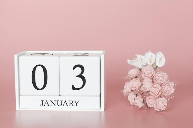 03 de janeiro. dia 3 do mês. cubo de calendário no fundo rosa moderno