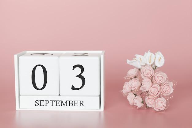 03 de setembro. dia 3 do mês. calendar o cubo no fundo cor-de-rosa moderno, no conceito do negócio e em um evento importante.