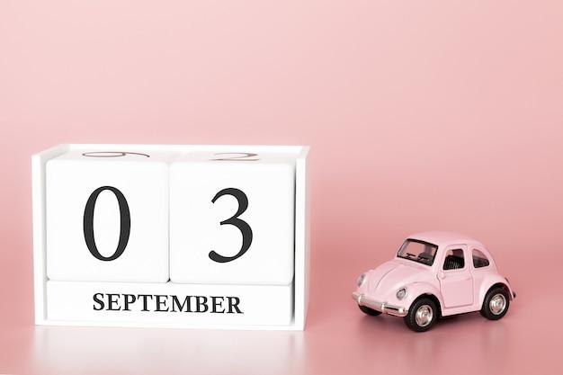03 de setembro. dia 3 do mês. cubo de calendário com carro